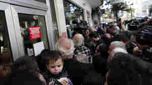 Banks in Cyprus reopened to customers for the first time in nearly two weeks Thursday, albeit with strict restrictions.