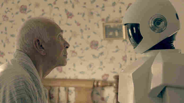 "In Robot & Frank, a robot cares for an aging ex-burglar who has dementia. Frank Langella, who plays the burglar, says his character ""becomes fond of the robot only because it is a tool for his wicked, wicked ways."""
