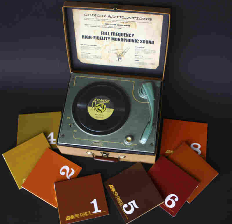 Ray Charles, Pure Genius - The Complete Atlantic Recordings (1952 - 1959)A box containing eight CDs, but made to look like an old record player, complete with a molded-plastic turntable under the lid.