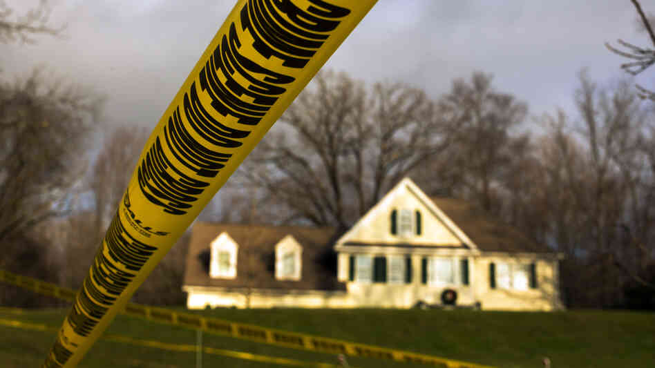 Dec. 18, 2012: Crime scene tape stretches across the property outside the home where Adam Lanza lived with his mother, Nancy Lanza. Inside, police found weapons and other evidence.