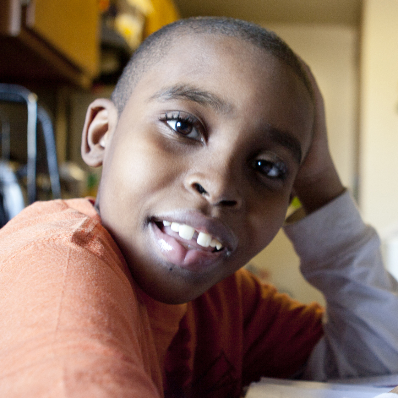 Jahleel Duroc, 10, does homework after school at his home in the Bronx, New York City. Jahleel receives disability benefits for asthma.
