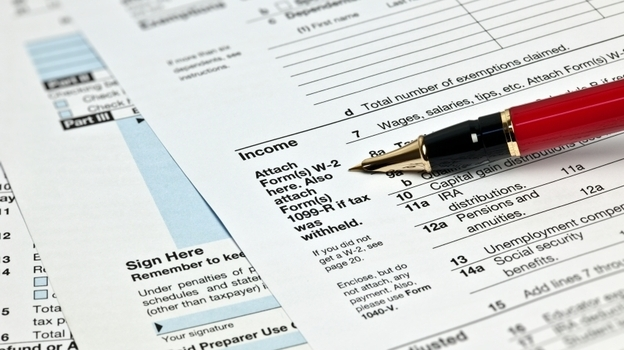 Taxes this year will be as much of a drag as ever. But not because of the Affordable Care Act. (iStockphoto.com)