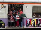 Passengers travel in a train car reserved for woman in Mumbai on March 8. The cars are offered in New Delhi and other places as well. Women say they like the security that the cars offer, but say men's attitudes need to change.