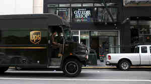 A UPS truck drives along Grant Street on in San Francisco, California.