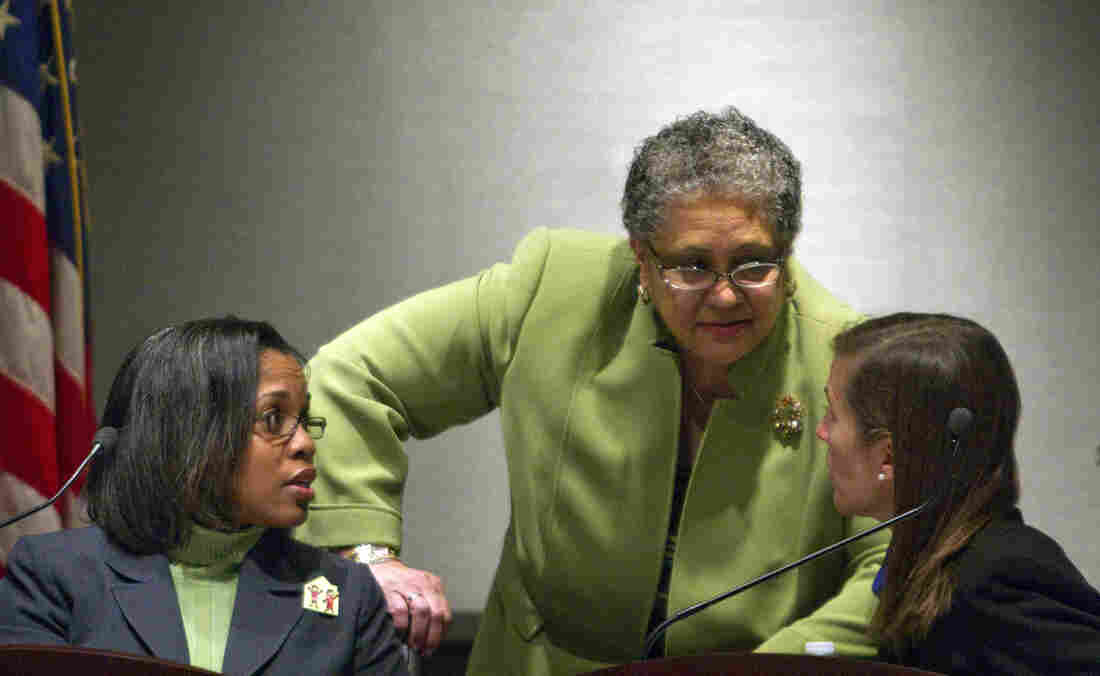 Former Atlanta Public Schools Superintendent Dr. Beverly Hall, center, speaks with school board member LaChandra Butler Parks, left, and Cecily Harsch-Kinnane, vice chair of the board, right.