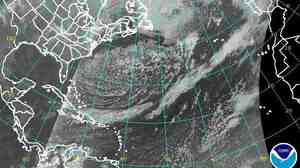 That's the coast of the U.S. on the left, the tip of Greenland at the top center and the coast of Europe on the top right. Meanwhile, the storm's tail extends down into the Caribbean.