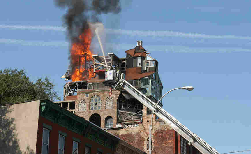 In October 2006, Broken Angel's tower caught fire. The New York City Department of Buildings declared the structure was dangerous and sought to demolish the home.