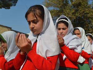 Schoolgirls pray for Pakistan's child activist Malala Yousafzai in Mingora in Pakistan's northwestern Swat Valley on Nov. 10. The teenager was shot by the Taliban for promoting girls' education.