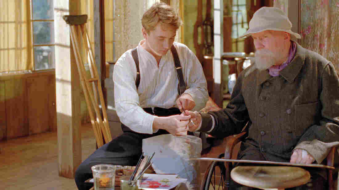 Jean (Vincent Rottiers) assists his ailing father, the artist Pierre-Auguste Renoir (Michel Bouquet), in his studio on the French Riviera.