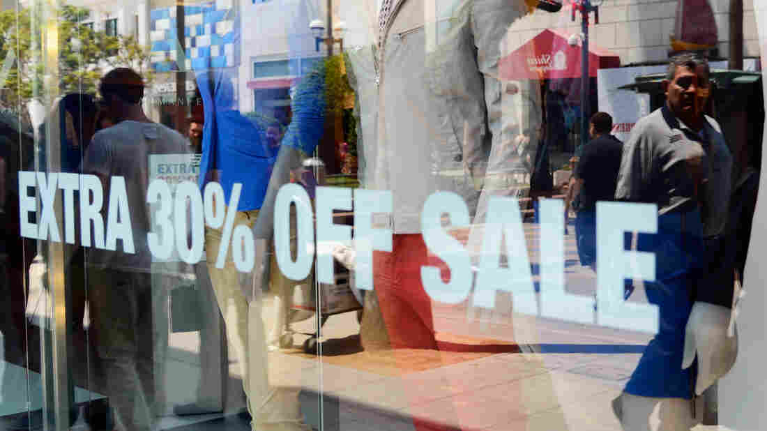 Retailers are doing all they can to attract consumers, who drive the economy. (File photo from 2012 of a store window in Santa Monica, Calif.)