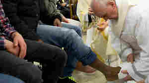 Pope Francis washes the feet of a prisoner at the Casal Del Marmo Youth Detention Center during the mass of the Lord's Supper on Th