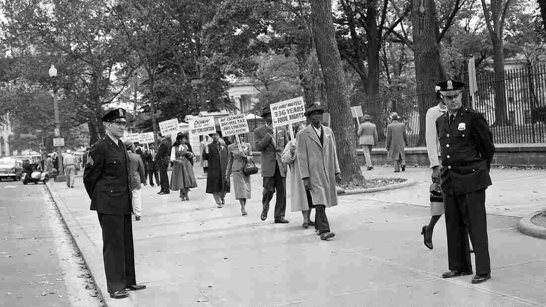 Officers stand by in 1955 as religious leaders from Chicago demonstrate outside the White House in Washington over the murder of 14-year-old Emmett Till.