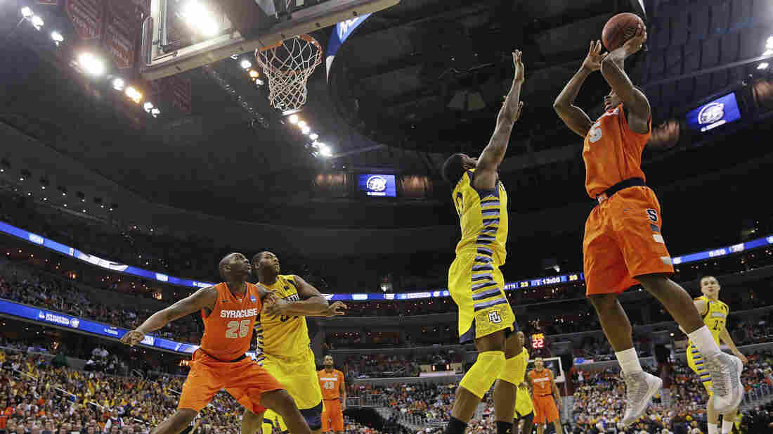 Syracuse forward C.J. Fair (No. 5) shoots over Marquette forward Jamil Wilson (No. 0) during the second half of the East Regional final in the NCAA men's college basketball tournament on Saturday.