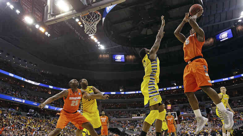 Syracuse forward C.J. Fair (No. 5) shoots over Marquette forward Jamil Wilson (No. 0) during the second half of the East Regional fina