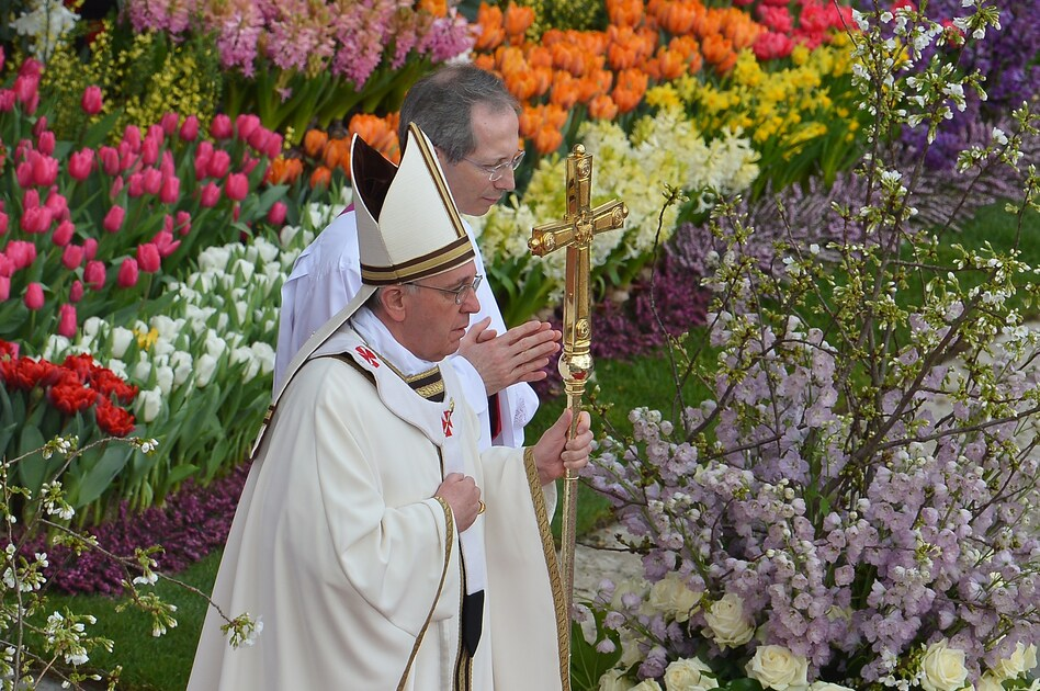 "The sun competed with clouds in the sky, but the square was a riot of floral color in Rome, where chilly winter has postponed the blossoming of many flowers. The pope advised people to let love transform their lives, or as he put it, ""let those desert places in our hearts bloom."" (AFP/Getty Images)"