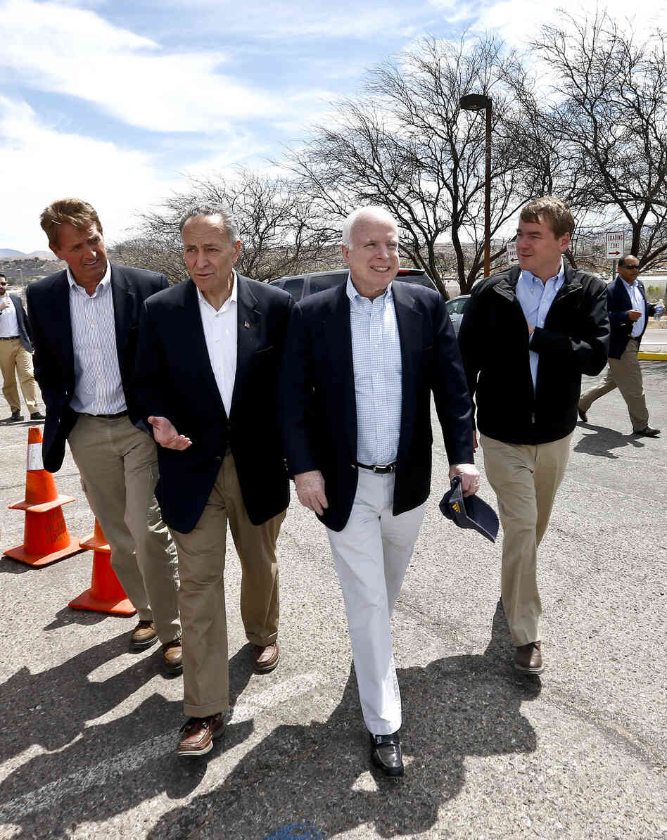 From left, Sen. Jeff Flake, R-Ariz., Sen. Chuck Schumer, D-NY, Sen. John McCain, R-Ariz., and Sen. Michael Bennett, D-Colo, arrive at a news conference after their tour of the M