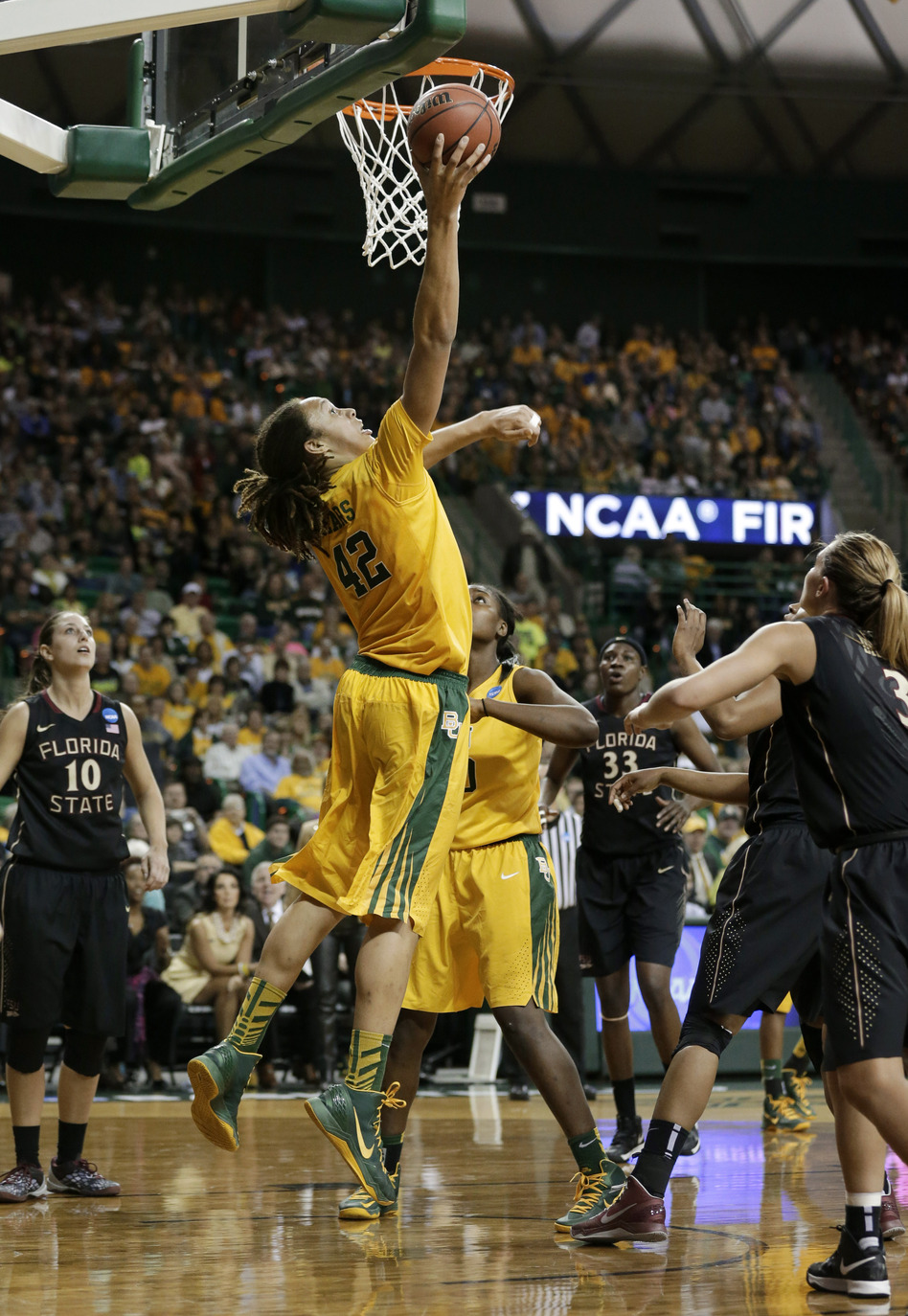 Baylor's Brittney Griner goes up to dunk in a second-round game of the NCAA women's college basketball tournament against Florida State on Tuesday in Waco, Texas. On Sunday, Baylor faces Louisville.