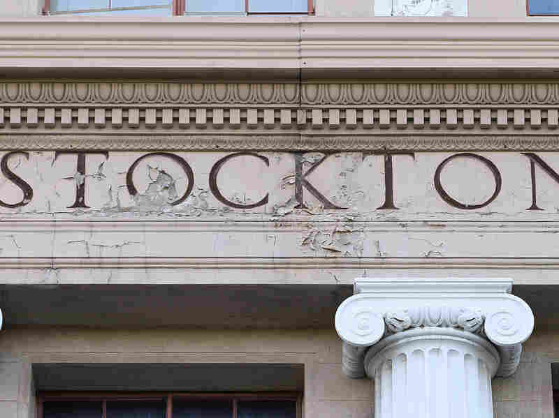 An aging sign at City Hall in Stockton, Calif. A judge has ruled that the city is eligible for federal bankruptcy protection.