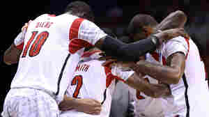 The Louisville Cardinals huddle up on the court after teammate Kevin Ware injured his leg in the first half against the Duke Blue Devils on Sunday.
