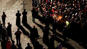 Parishioners partake in the Way Of The Cross procession at the Colosseum on Good Friday in Rome. A group of women Catholics recently made a pilgrimage to Rome to request that women once again be allowed to hold leadership positions in the church.