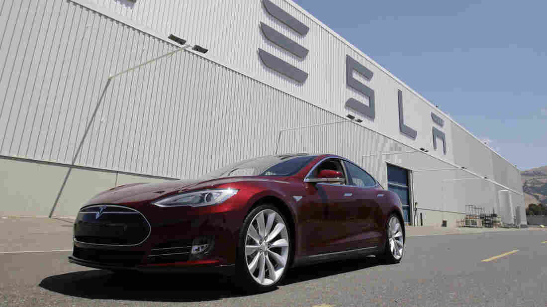 A Tesla Model S drives outside the Tesla factory in Fremont, Calif., on June 22. The electric car was named Automobile of the Year by Automobile Magazine and Car of the Year by Motor Trend.
