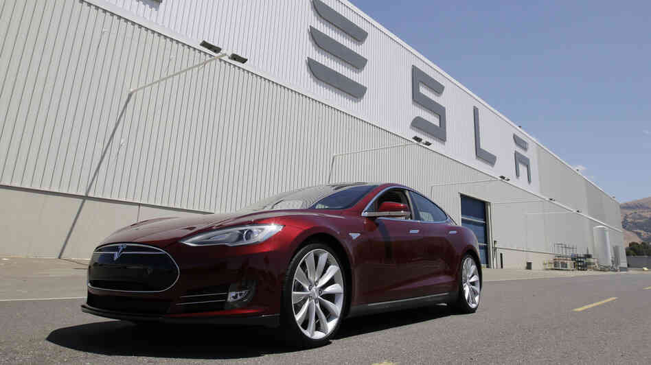 A Tesla Model S drives outside the Tesla factory in Fremont, Calif., on June 22. The e