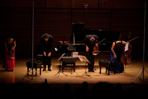 "Pianist Jonathan Biss with three members of the London-based Elias String Quartet (violinist Sara Bitlloch, violist Martin Saving, and cellist Marie Bitlloch) take bows after Mozart's Piano Quintet in E-flat, a piece Biss says ""thrives so much on the small and unexpected detail."""