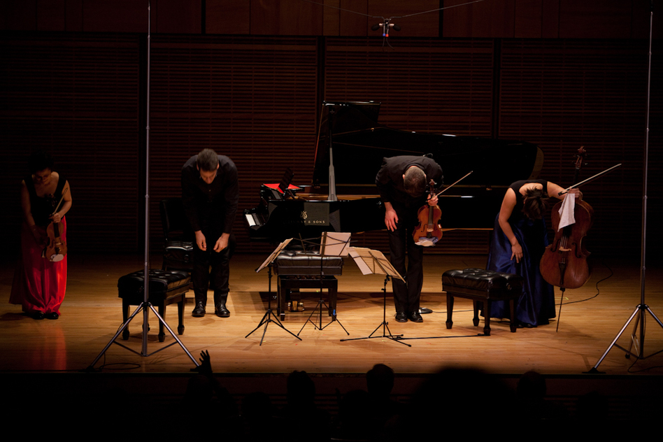 """Pianist Jonathan Biss with three members of the London-based Elias String Quartet (violinist Sara Bitlloch, violist Martin Saving, and cellist Marie Bitlloch) take bows after Mozart's Piano Quintet in E-flat, a piece Biss says """"thrives so much on the small and unexpected detail."""" (For NPR)"""