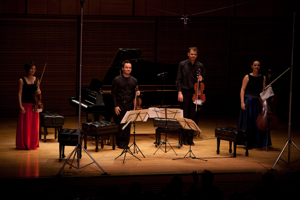 The Elias String Quartet performers -- violinists Sara Bitlloch and Donald Grant, violist Martin Saving and cellist Marie Bitlloch -- acknowledging the applause from the appreciative audience at Zankel Hall.
