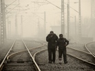 Men walk along a railway line in Beijing on Jan. 12, as air pollution reached hazardous levels.