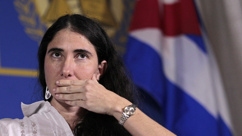 Yoani Sanchez, internationally known dissident blogger from Cuba, listens to a question as she speaks at the Freedom Tower in Miami on Monday.