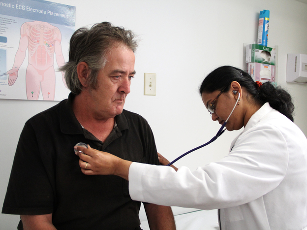 Dr. Madhumathi Gunasekaran examines John Pike at the Northgate II clinic in Camden, N.J.