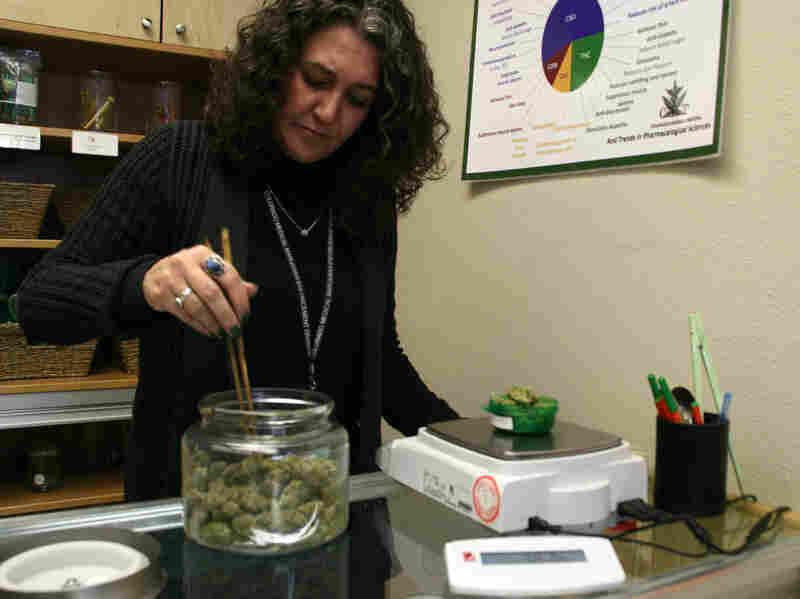 Erica Freeman of Choice Organics weighs medical marijuana for a customer.