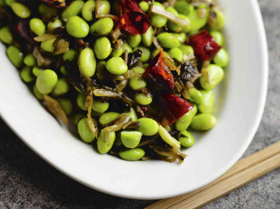 Young soybeans, often known as edamame, are firmer than peas. Cookbook author Fuchsia Dunlop says they make an easy and delicious dinner when stir-fried.