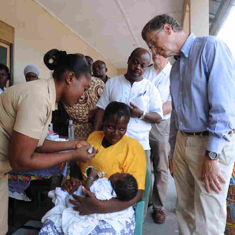 Bill Gates watches as a child is vaccinated at the Ahentia Health Centre in Ghana in March.