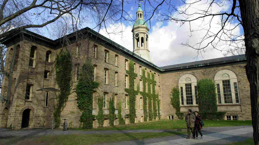 A couple walks past Nassau Hall on the Princeton Unversity campus in Princeton, N.J. A letter to the editor in The Daily Princetonian urging female students to find a husband before they graduate has drawn criticism.