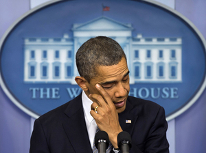 President Obama wipes away tears as he talks about the Connecticut elementary school shooting on Dec. 14, 2012, in the White House briefing room. Obama was in Colorado on Wednesday and planned to visit Connecticut next week to keep pushing for new gun laws.