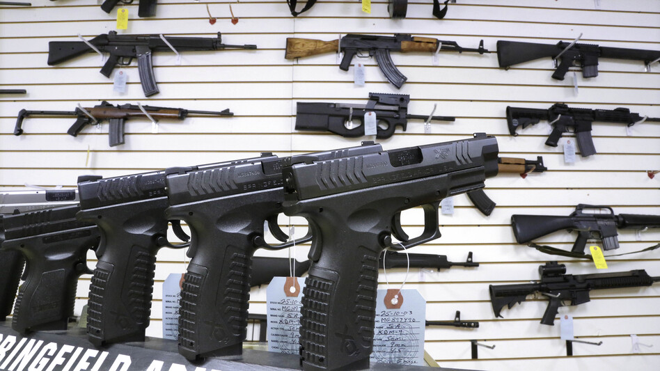 Assault weapons and handguns for sale at Capitol City Arms Supply in Springfield, Ill., on Jan. 16. Congress has yet to vote on legislative efforts to enact new gun control laws, nearly four months after the Newtown, Conn., school shootings. (Seth Perlman/AP)