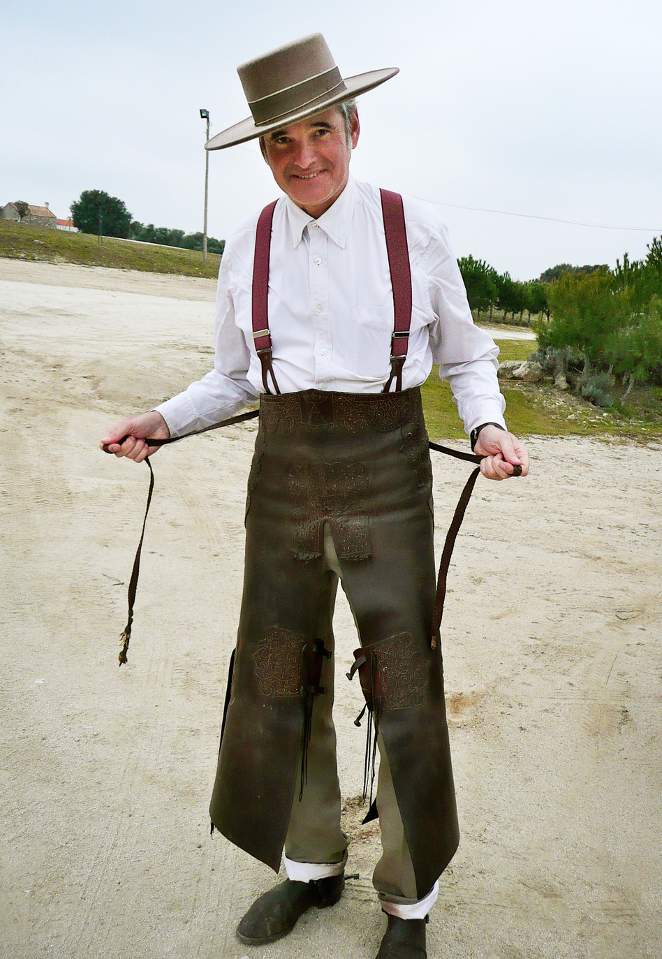 Jaime Patino shows off the leather chaps and 19th-century-style suit he wears while riding horses and hunting wild boar. Parts of his outfit belonged to his grandfather, who also loved hunting.
