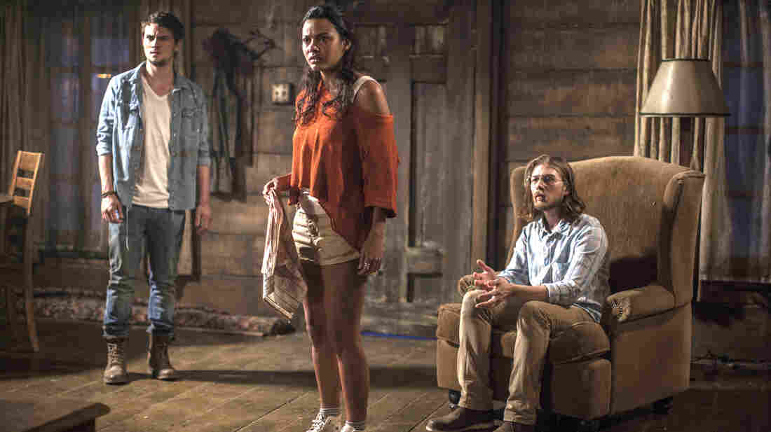 David (Shiloh Fernandez), Olivia (Jessica Lucas) and Eric (Lou Taylor Pucci) fall victim to demonic terrors in the gritty horror remake Evil Dead.