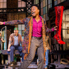 Struggling shoe-factory owner Charlie (Stark Sands, left) is inspired by drag queen Lola (Billy Porter) to make high-quality high-heeled boots for men who perform as women in the Broadway adaptation of the cult film Kinky Boots.