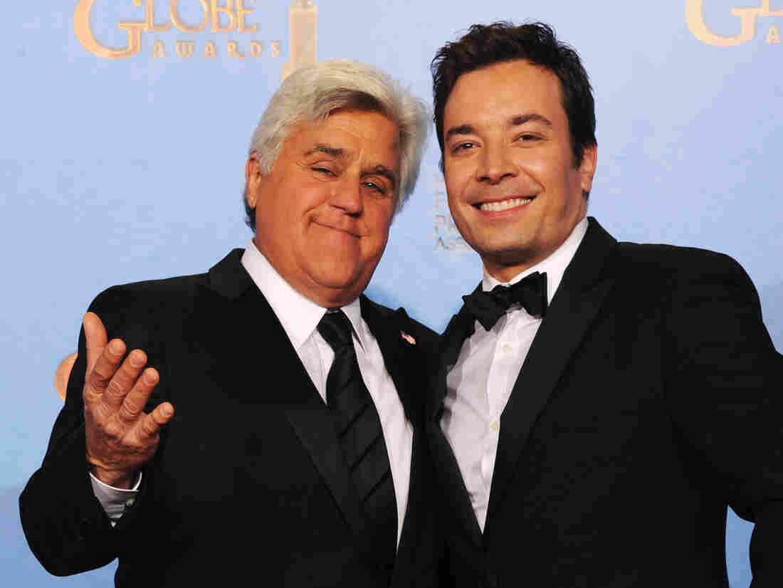 Jay Leno (left) and Jimmy Fallon at the Golden Globe Awards in January. Next year, Fallon will be taking Leno's place on The Tonight Show, NBC says.