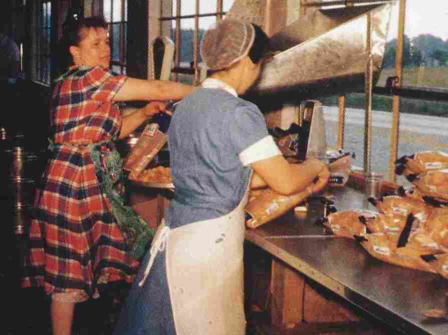 Mim Herr (right), with Mary Wowrer, packing chips by hand.
