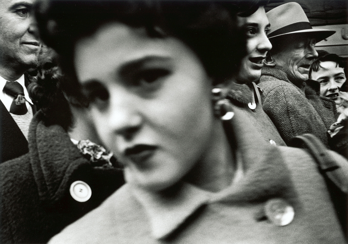 Big face in crowd, New York, 1955