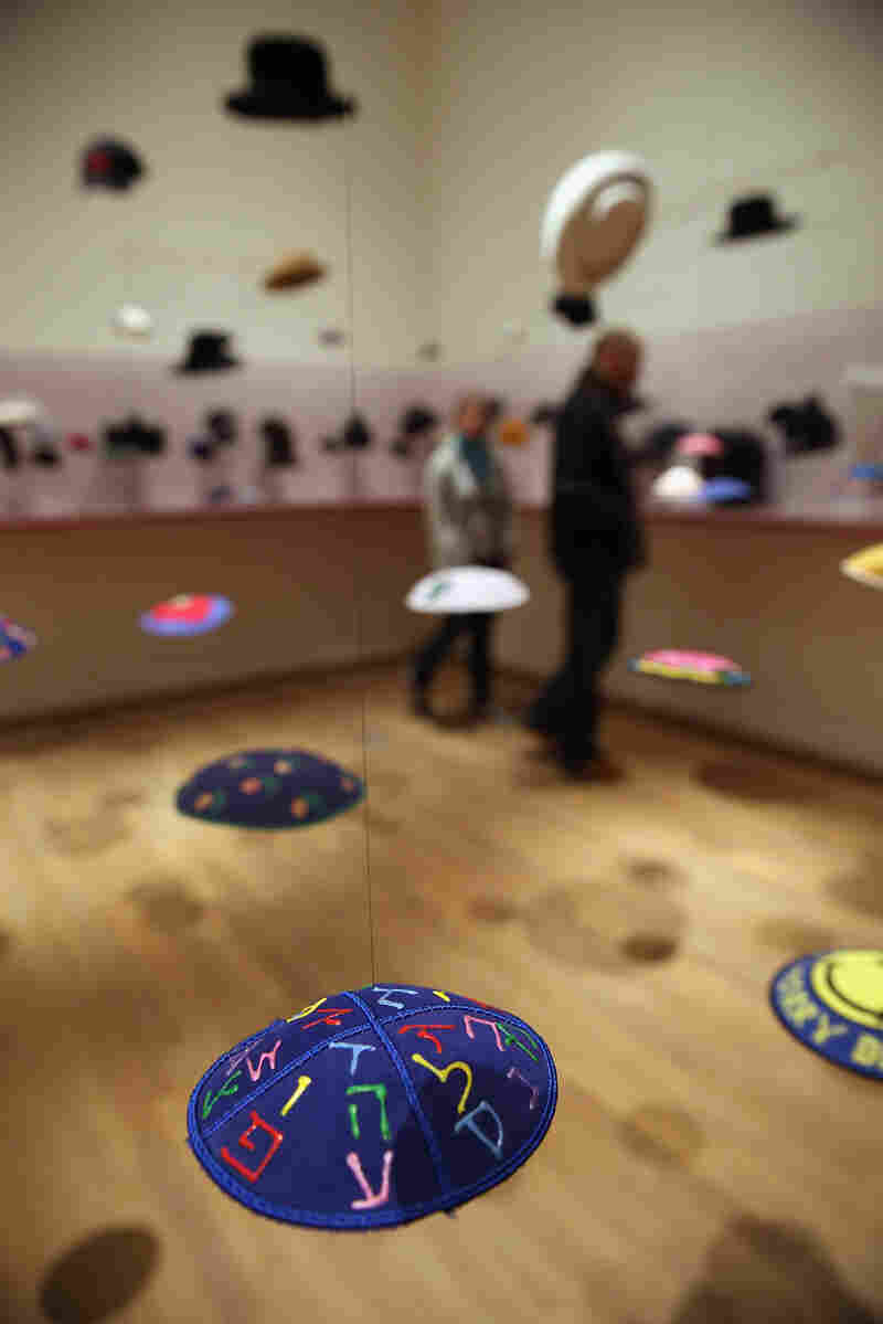 """""""The Whole Truth"""" exhibit has a section that features yarmulkes, hats and other Jewish headwear."""