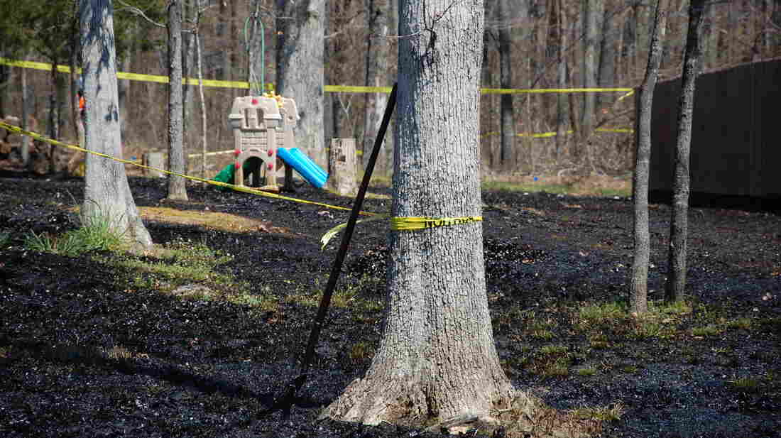 Oil covers the ground around a slide in Mayflower, Ark., on April 1, days after a pipeline ruptured and spewed oil over lawns and roadways.