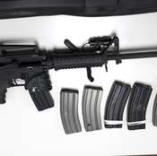 A Bushmaster rifle, similar to the type used by Adam Lanza during the shooting at Sandy Hook Elementary School, and some ammunition magazines. The sale and possession of this type of weapon, and high-capacity magazines, will be severely restricted in Connecticut under new legislation.