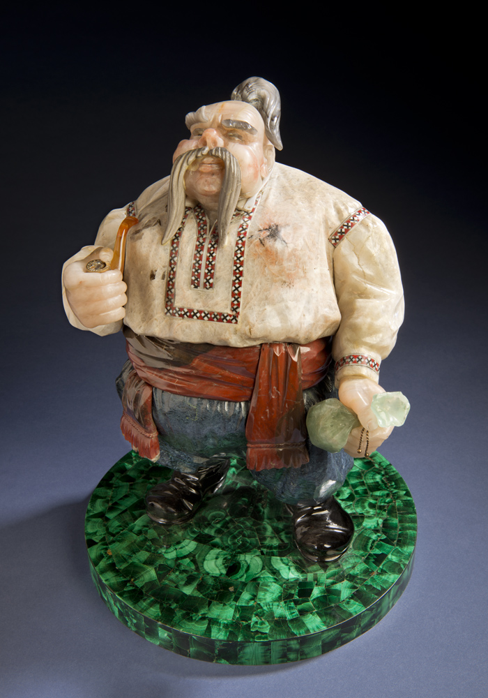 Cossack, completed in 1979, is another classic image, which reflects Konovalenko's Ukrainian heritage. It was completed in 1979. The base of the sculpture is nephrite; the Cossack's shirt is cacholong, a form of opal, and includes enamel inlay. It measures about 11 inches tall.
