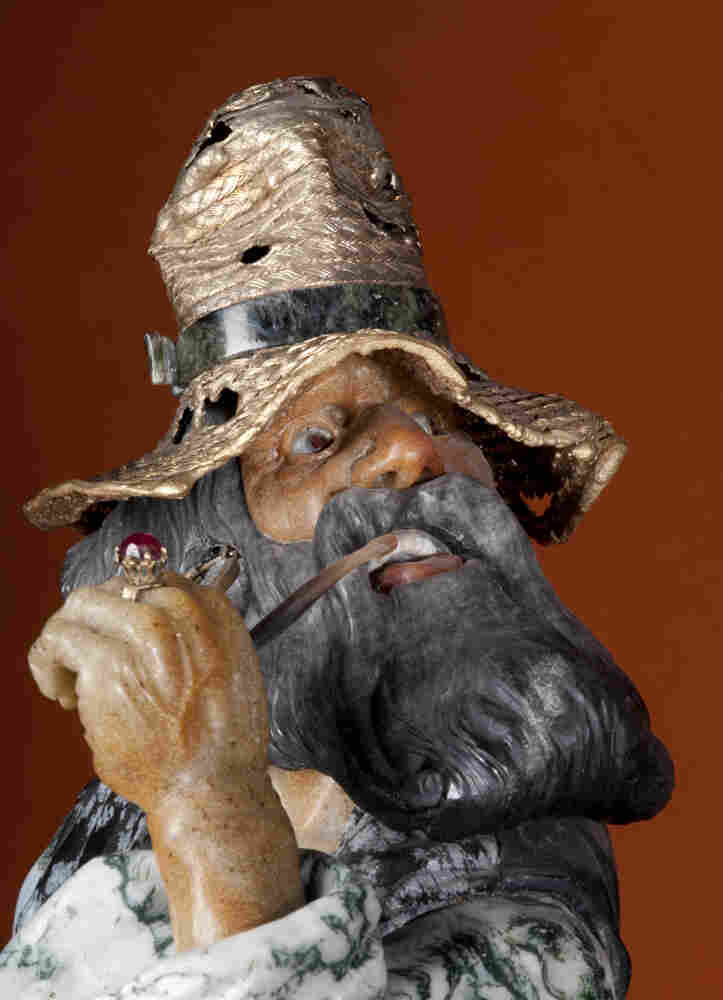 A close-up of the man in Gypsies, one of the last sculptures Konovalenko made, shows the artist's extraordinary level of detail. The veins and the tendons are visible on the man's hand. His hat is gold-plated silver; his eyes and ring are ruby; his face is Beloretsk quartz.