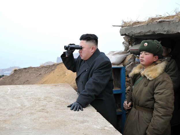 In this photo released in March by the North's Korean Central News Agency (KCNA), leader Kim Jong Un is said to be using a pair of binoculars to look south during an inspection of army troops stationed